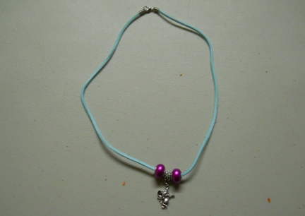 Purple Necklace with Purple and Rattie Charms